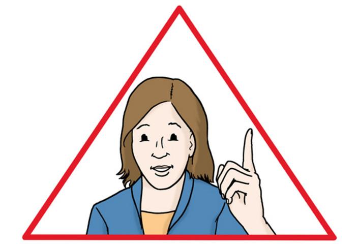 Frau mit erhobenem Zeigefinger in einem Warndreieck