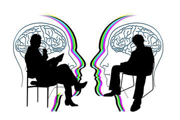 Bild wird vergrößert: Zwei Menschen sitzen sich auf einem Stuhl gegenüber und sprechen miteinander. Im Hintergrund sind Shilouetten zwei sich zugewandter Köpfe zu sehen.