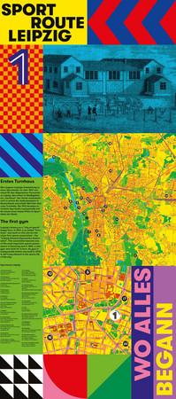 "Bunte Wandtafel mit Stadtplanausschnitt und dem ASchriftzug ""Wo alles begann"""