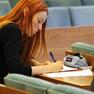 Werkstatt Finanzen am 21. Oktober - Bild einer schreibenden Bürgerin