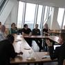 Diskussionsteilnehmer bei einem Gruppengespräch