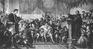 Schwarz-Weiß-Zeichnung der Leipziger Disputation. Luther und Eck stehen sich jeweils an einem erhöhten Redepult sprechend gegenüber.