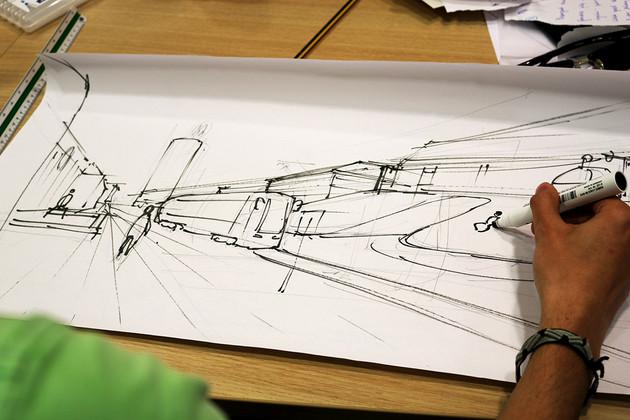 Eine Hand zeichnet einen Entwurf